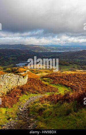 South Lakeland fells from Lingmoor Fell with Elter Water and Windermere in the distance. Lake District National - Stock Photo