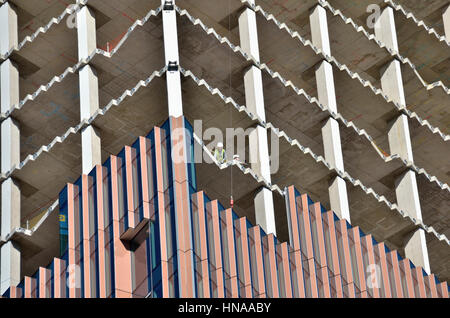 Close up of an office building under construction showing core and cladding. - Stock Photo
