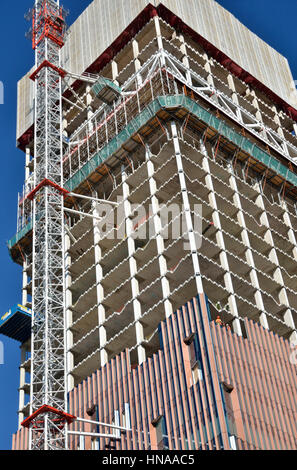 Close up of an office building tower under construction showing core and cladding. - Stock Photo