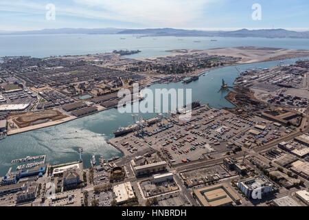 Oakland, California, USA - September 19, 2016:  Aerial view of the Port of Oakland, Alameda Island and San Francisco - Stock Photo