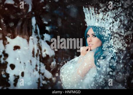 Snow Queen in Winter Fantasy Landscape - Stock Photo