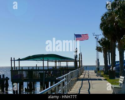American Flag on the Docks Blowing in a Stiff Breeze, Cedar Key, Florida, USA - Stock Photo