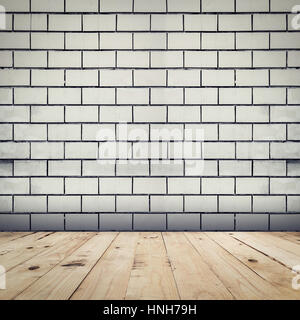 Grunge white brick wall background and wood floor perspective room interior. - Stock Photo