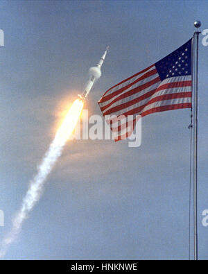 The American flag heralded the launch of Apollo 11, the first Lunar landing mission, on July 16, 1969. The massive - Stock Photo
