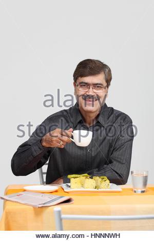 Man having a cup of tea - Stock Photo