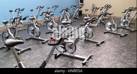 Health club cycle spinning room with bikes. - Stock Photo
