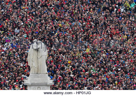 People look on and listen as President Donald Trump delivers his inaugural address during the Inauguration in Washington, - Stock Photo