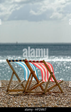 Two Empty Deck Chairs on a Beach - Stockfoto