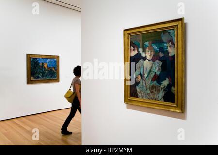 MoMA ( Museum of Modern Art).Right, Henri Toulouse Lautrec, La goulveat the moulin rouge. Left, Paul Cézane, Châteurnoir,New - Stock Photo