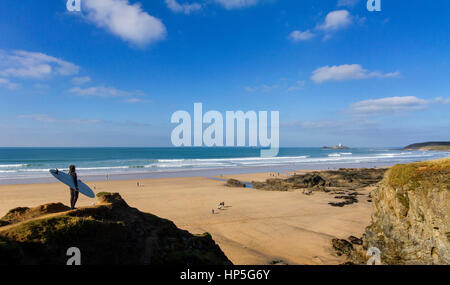 Checking the surf at Godrevy in Cornwall - Stock Photo