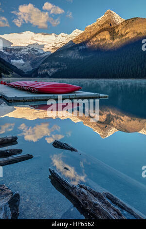 Red canoes on the dock at lake Louise in Banff National Park, Alberta, Canada. - Stock Photo