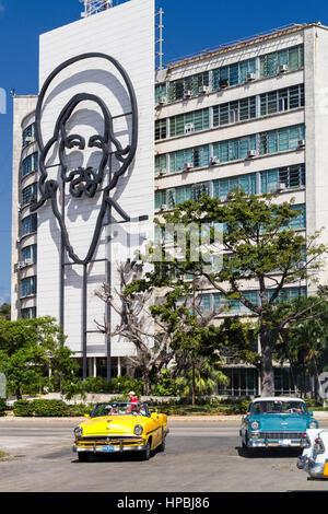 Interior ministry, picture of Che Guevara, Placa de la Revolucion Square, Taxi, Havana, Cuba, Caribbean - Stock Photo