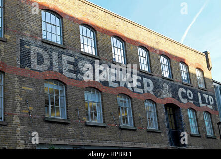 Text on the exterior of the old Diespeker Wharf timber mill building converted to offices on City Road Basin, Regents - Stock Photo