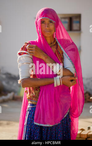 RAJASTHAN, INDIA - NOVEMBER 20, 2016: An Unidentified Rajasthani woman wearing a traditional dress with pink sari - Stock Photo