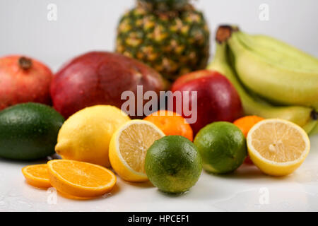 Collection of different tropical fruits on white background - Stock Photo