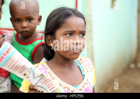 Unidentified Happy Indian rural school girl at their Village - Stock Photo