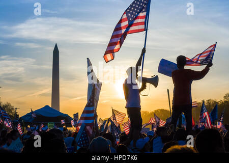 Protest on the National Mall in Washington DC. Immigrant waving flag holding a bullhorn at peaceful march of illegal - Stock Photo