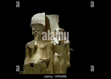 Italy, Piedmont, Turin, Egyptian Museum of Torino, Statue of Tutankhamon and Amon - Stock Photo