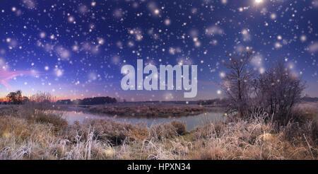 Christmas night with snowfall. Night xmas background. White snowflakes on night sky. - Stock Photo