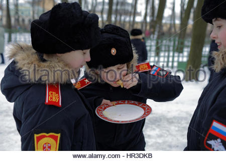 St. Petersburg, Russia, 26th February, 2017. Cadets of Suvorov military school eating blinis during Shrovetide celebrations - Stock Photo