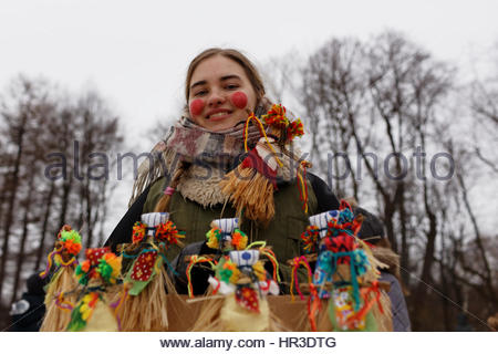 St. Petersburg, Russia, 26th February, 2017. Woman selling the effigies of Maslenitsa during Shrovetide celebrations - Stock Photo