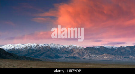 Clouds over Panamint Range at sunrise seen from Mesquite Flat Sand Dunes, Death Valley, California, USA - Stock Photo