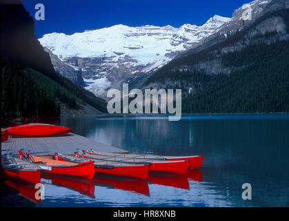 Red Canoes, Lake Louise, Banff National Park, Alberta, Canada - Stock Photo