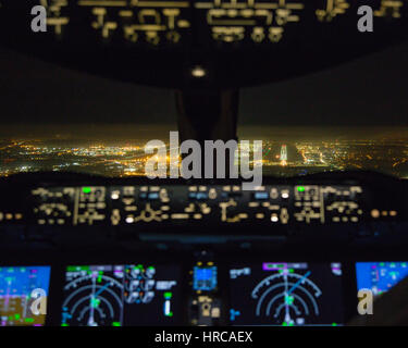 Night view of the approach to London Heathrow airport from the flight deck of a Boeing 787 - Stock Photo