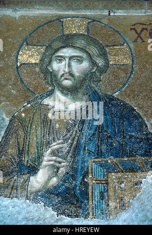 Jesus Christ or Christ Pantocrator Holding a Bible Byzantine Mosaic (c1261) part of the Deësis Mosaic in the Hagia - Stock Photo