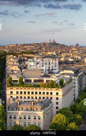 Overhead view of Paris from top of Arc de Triomphe with Basilique du Sacre Coeur beyond, Paris, France - Stock Photo
