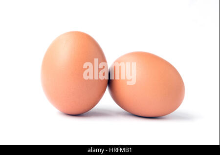 Two brown chicken eggs isolated on white. - Stock Photo
