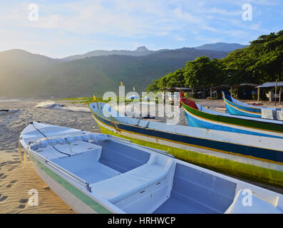 Traditional colourful boats on the beach in Bonete, Ilhabela Island, State of Sao Paulo, Brazil - Stock Photo