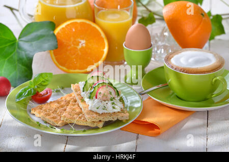 Light breakfast with cottage cheese crispbread and a cup of cappuccino - Stock Photo