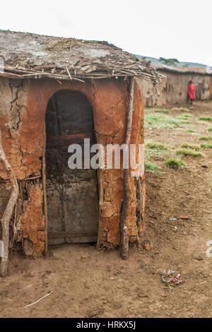 Mud house of a Masai Village in Kenya - Stock Photo