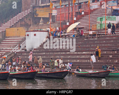 Pilgrims bathing in the early morning at Dasawamedh ghat on the river Ganges at Varanasi, India. Devout Hindus travel - Stock Photo