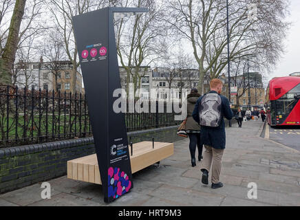 Public solar-powered 'smart bench' for charging mobile devices, Islington, London - Stock Photo