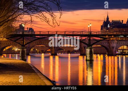 Sunrise on the Seine River, Pond des Arts and Pond Neuf in the 1st Arrondissement of Paris (Ile de la Cite), France - Stock Photo