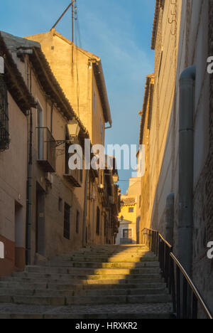 Evening at the streets of old town of Toledo, falling light at the stairs. - Stock Photo