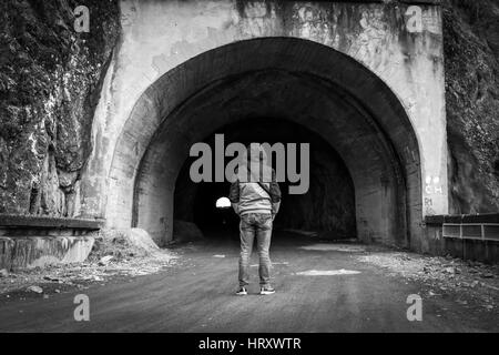 Man entry in a tunnel - Stock Photo