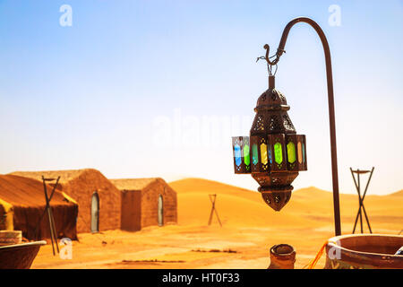 coloreful berber lamp with traditional nomad tents on background - Stockfoto