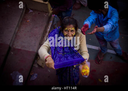 Residents of Barsana near Mathura in Uttar Pradesh celebrated 'Laddoo Holi' by smearing one another with coloured - Stockfoto