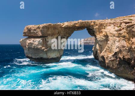 The Azure Window with crashing waves at daytime on Gozo, Malta - Stock Photo