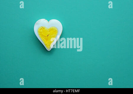 Egg heart on Turquoise color background. Romantic sign background concept - Stock Photo