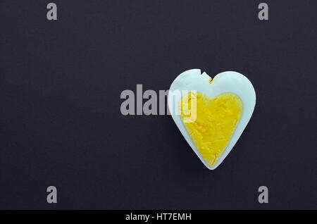 Egg heart on black background. Romantic background concept - Stock Photo