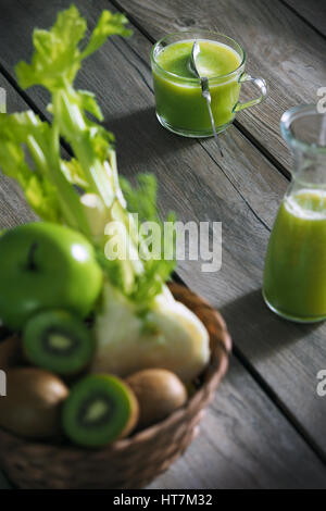 kiwi, green apple and fenel juice in glass on the table - Stock Photo