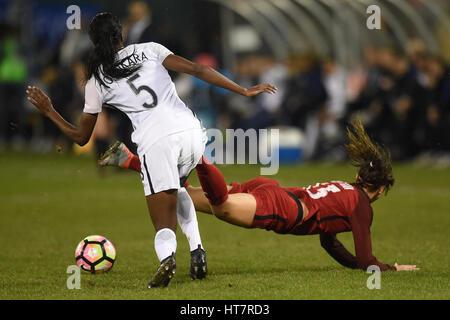 Washington DC, USA. 07th Mar, 2017. USA's Alex Morgan (13) gets tripped up by France's Aissatou Tounkara (5) during - Stock Photo