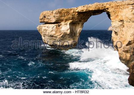 Gozo Malta: Azure Window, Mediterranean sea coast on, a touristic popular location,  landmark for tourists, view - Stock Photo