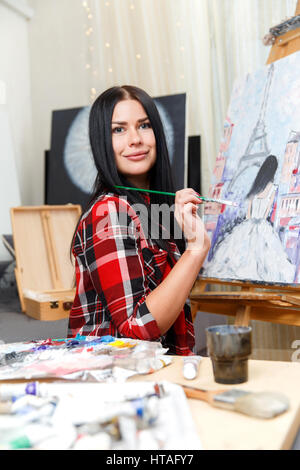 Long-haired brunette in plaid shirt - Stock Photo
