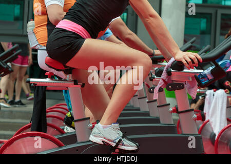 Group of Boys and Girls at Gym: Workout with Spinning Bikes - Stockfoto