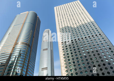 Three skyscrapers on the blue sky background in Singapore. View from below. Horizontal. - Stock Photo